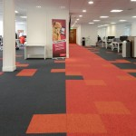 up & balance grayscale carpet tiles at Virgin Trains Head Office